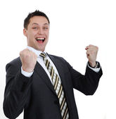 Businessman lifting arms in excitement — Stock Photo