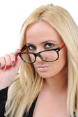 Beautiful blonde girl with her glasses — Stock Photo