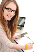 Smiling college girl doing homework — Stockfoto