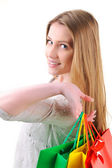 Closeup image of a teen girl holding shopping bags — Stock Photo