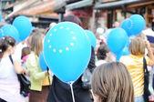 Group of teenage holding eu balloons — Stock Photo