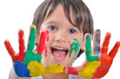 Happy kid with paints on hands — Stock Photo