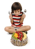Kid eating cake — Stock Photo