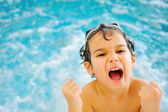 Child happiness in pool — Stock Photo