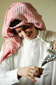 Arabic young man pouring a traditional coffee — Stock Photo