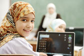 Children at school classroom — Stockfoto