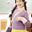 Cute little girl at school — Stock Photo