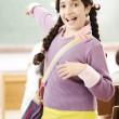 Cute little girl at school — Stock Photo