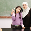 Teacher and little girl together — Stock Photo