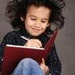 Smiling little boy drawing — Stock Photo