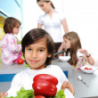 Little boy in kitchen cooking with his family — Stockfoto