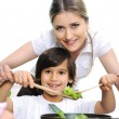 Beautiful mother and little son in kitchen together — Stock Photo #10420623