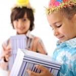 Birthday party, happy children celebrating, balloons and presents around — Stock Photo #10420703