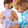Cute kid receiving birthday present box — Stock Photo #10420705
