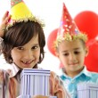 Birthday party, happy children celebrating, balloons and presents around — Stock Photo