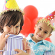 Birthday party, happy children celebrating, balloons and presents around — Stockfoto
