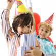 Birthday party, happy children celebrating, balloons and presents around — Stock Photo #10420726