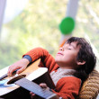 Stock Photo: Kid playing guitar at home