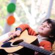 Kid playing guitar at home — Stock Photo #10420738