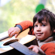 Kid playing guitar at home — Stock Photo
