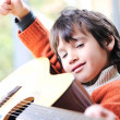 Kid playing guitar at home — Stock Photo #10420754