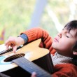 Little boy playing guitar at home — Stock Photo #10420765