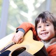 My son playing guitar at home — Stock Photo