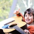 Little boy playing guitar at home — Stock Photo
