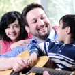 Happy family playing guitar together — Stock Photo #10420832