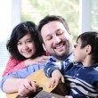 Happy family playing guitar together — Stock Photo #10420838