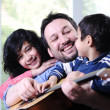 Father and his children having good time at home — Stock Photo #10420847