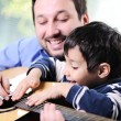 Royalty-Free Stock Photo: Father and son playing guitar at home