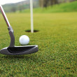 Golf ball and stick on green grass — Foto Stock