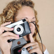 Stock Photo: Blonde girl with retro camera