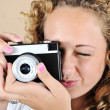 Excited girl with holding camera — Stock Photo