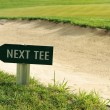 Next tee sign arrow direction golf field — Stock Photo
