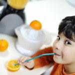 Little boy with orange — Stock Photo #10421104