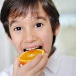 Orange and kid — Stock Photo #10421114