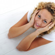 Happy young girl lying on floor at home — Stock Photo #10421139