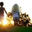 Foto Stock: Happy children in nature at sunset