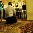 Salat layl - praying in mosque at night Ramadan - Stock Photo