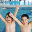 Two kids at pool - Stock Photo