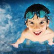 Little boy at swimming pool with goggles — Stock Photo #10421515