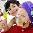 Parenting with little son playing with messy colors — Stock Photo #10421522