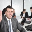 Portrait of young businessman in the office with thumb up — Stock Photo #10421620