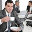 Businessmin business ambience drinking cofee — Stockfoto #10421623