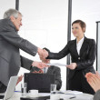 Royalty-Free Stock Photo: Happy business leaders handshaking at meeting
