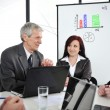 Business meeting - group of in office at presentation — 图库照片