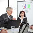 Business meeting - group of in office at presentation — Stockfoto