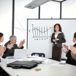 Foto Stock: Business woman making the presentation and receiving applause